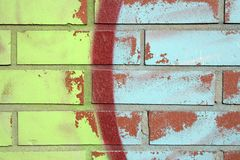 Colorful graffiti on a wall. Colorful graffiti on a brick wall, and peeling paint royalty free stock photos