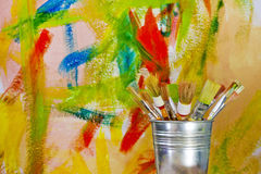 Colorful graffiti wall background and brushes Royalty Free Stock Images