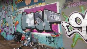 Colorful Graffiti Wall and Garbage Bin in Ghetto, Pan Shot