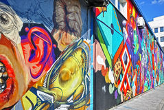 Colorful graffiti wall stock photos