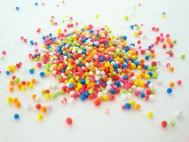 Colorful grains on white background Royalty Free Stock Images