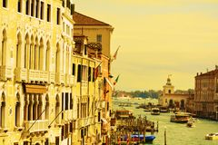 Colorful Grand Canal in yellow hues, in Venice, Italy stock photos