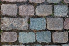 Colorful granite cobblestoned street Royalty Free Stock Image