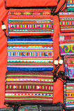 Colorful graphic hill tribe hand made bag. Colorful graphic hill tribe in northern of thailand hand made bag on red background Royalty Free Stock Images