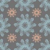 Colorful graphic rose snowflake on a gray background. Floral seamless pattern. Graphic rose snowflake   flowers handmade pink blue background seamless pattern Stock Image