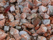 Colorful gravel background. Background of colorful red and gray gravel or stones Stock Photo