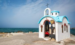 Colorful greek orthodox chapel by the sea near Chania in Crete Greece. Colorful greek orthodox chapel by the sea near Chania in Crete, Greece Stock Images