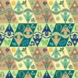 Colorful green, blue, brown, modern vector tribal African pattern. Vector tribal ethnic African green and brown geometric pattern with eye symbol, floral and vector illustration