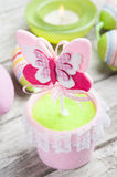 Colorful green easter eggs and lit candle Stock Photos