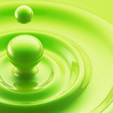 Colorful green liquid drop with waves Stock Photo