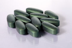 Colorful green pills Stock Images