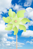 Colorful green pinwheel over blue sky Royalty Free Stock Image
