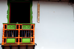 Colorful green and red house front with balcony in Royalty Free Stock Photos