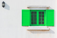 Colorful green window and Detail of house exterior. Stock Images
