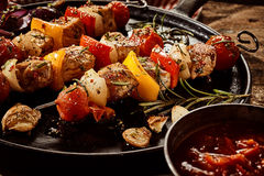 Colorful grilled skewers with meat and vegetables Stock Photos