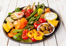 Colorful Grilled Vegetable Bounty on Picnic Table Stock Image
