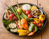 Colorful Grilled Vegetables and Olives on Iron Pan Stock Photo