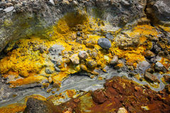 Colorful ground with creek in the volcanic desert Royalty Free Stock Photo