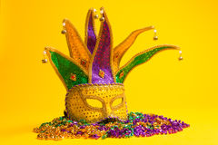 Colorful group of Mardi Gras or venetian mask or costumes on a y Royalty Free Stock Photos
