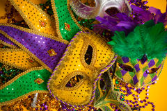 Colorful group of Mardi Gras or venetian mask or costumes on a y Stock Images