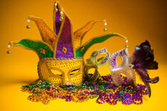 Colorful group of Mardi Gras or venetian mask on yellow Stock Photography