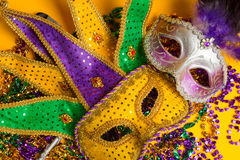 Colorful group of Mardi Gras or venetian mask on yellow Stock Photos