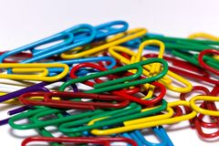 Colorful group of office clips on white background Stock Image