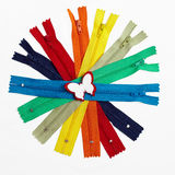 Colorful group of zippers gathered in circle Stock Image