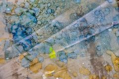 Colorful grunge splattered paint background element with blue and gold royalty free stock photo