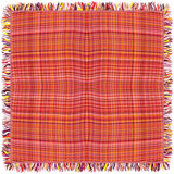 Colorful grunge striped and checkered weave tablecloth with fringe. Isolated on white Stock Photos