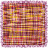 Colorful grunge striped and checkered weave tablecloth with fringe. Isolated on white Royalty Free Stock Image