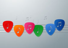 Colorful Guitar Picks with Music Notes Stock Photography