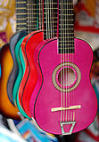 Colorful guitars in musical instruments shop stock images