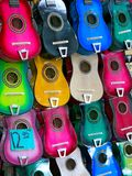 Colorful guitars for sale in bazaar shop stock photos