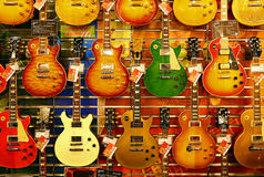 Colorful guitars for sale stock images