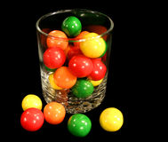 Colorful gumballs.. A bunch of colorful gumballs in a glass Stock Images