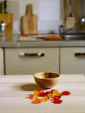 Colorful Gummy Bear Candy on wooden table on kitchen  background Royalty Free Stock Photo