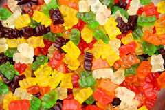 Colorful gummy bears or jellybears candies. Group of sweet colorful gummy candies on street market as a background Stock Photos