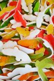 Colorful gummy fish candies background stock photo