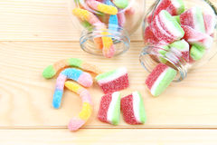 Colorful gummy  in jars. Gummy candy in jars in the wood background Stock Photo