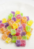 Colorful gummy. Colorful triangle shape colorful gummy in white plate Stock Image