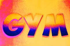 Colorful GYM sign in capital letters stock photos