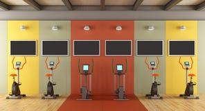 Colorful gym with statiobary bike Stock Photos