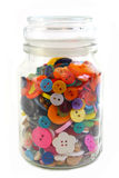 Colorful Haberdashery buttons in a glass jar. Vertical on White Royalty Free Stock Images