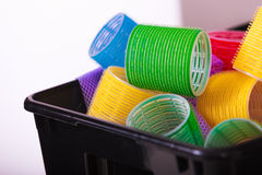 Colorful hair rollers curlers in basket. Hairdressing beauty salon. Royalty Free Stock Photo