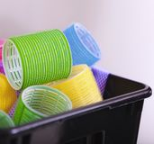 Colorful hair rollers curlers in basket. Hairdressing beauty salon. Stock Photography