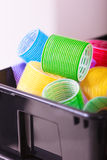 Colorful hair rollers curlers in basket. Hairdressing beauty salon. Royalty Free Stock Photos