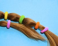Colorful hair ties on a blue background. royalty free stock image