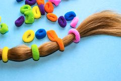 Colorful hair ties on a blue background. royalty free stock photos