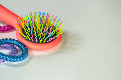 Colorful hairbrush with holders for hair Stock Photography